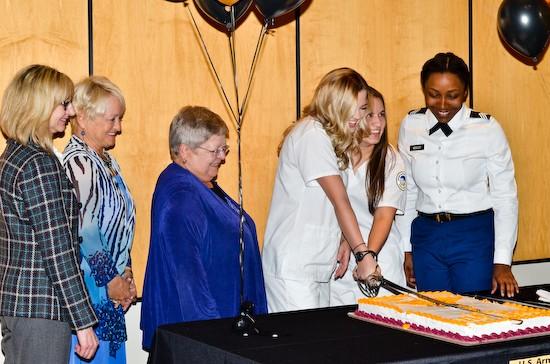 School of Nursing Professor Dr. Ursula Pritham, Nursing Chair Dr. Sharon Radzyminski, Interim President Jean Bartels, and Cadets Karaline Schmitz, Jenny Garcia, and Tyauna Ellison performed the ceremonial cake cutting.