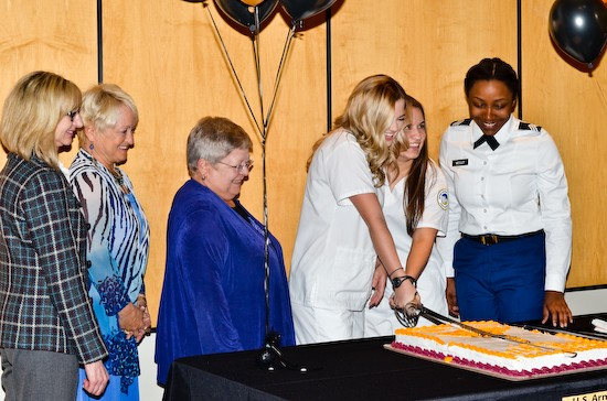 School of Nursing Professor Dr. Ursula Pritham, Nursing Chair Dr. Sharon Radzyminski, Interim President Jean Bartels, and Cadets Karaline Schmitz, Jenny Garcia, and Tyauna Ellison performed the ceremonial cake cutting.